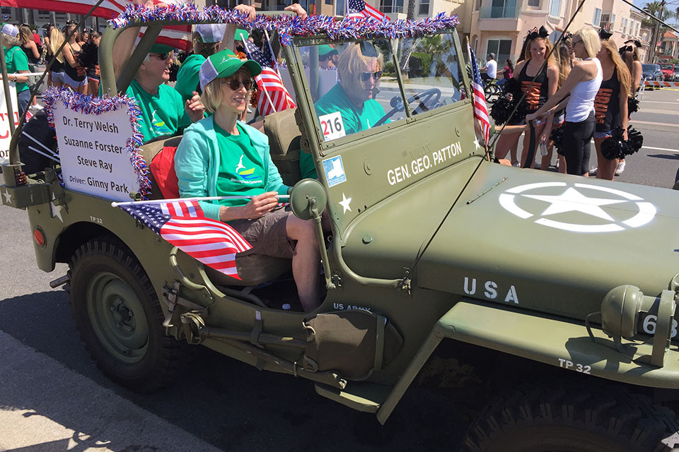 Virginia Park drives BRC board members in her World War II Jeep replica.