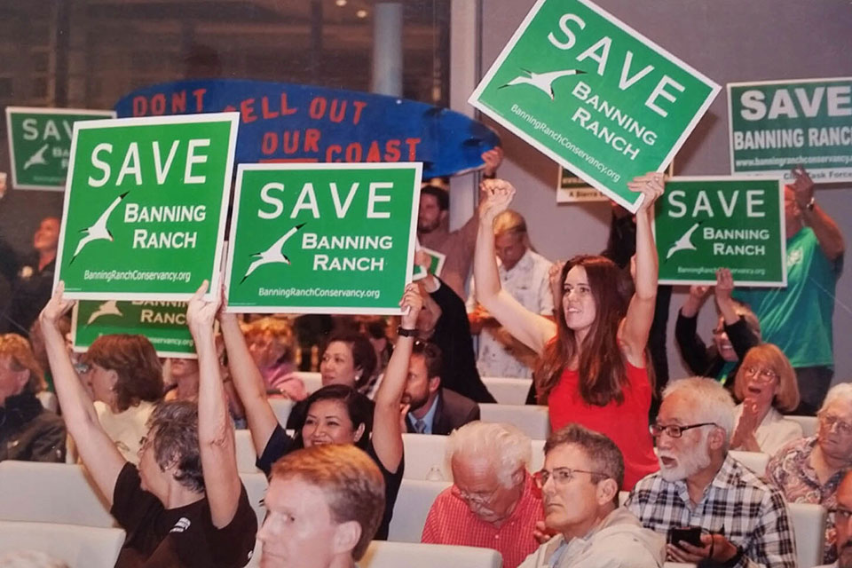 Supporters react at Coastal Commission hearing on Banning Ranch.